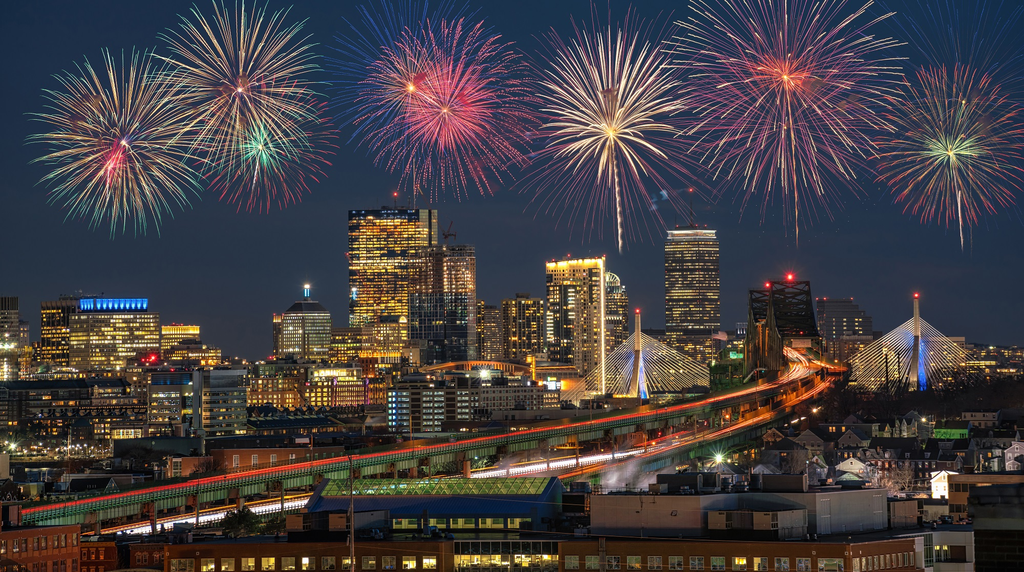Fourth of July fireworks over city.