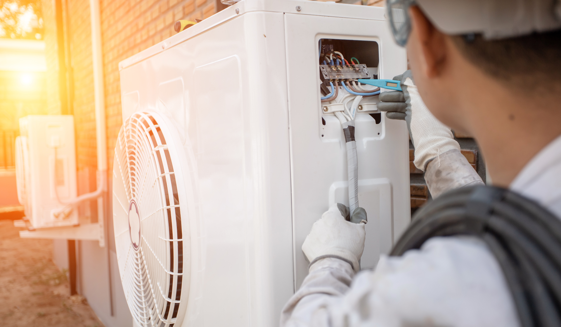 Person working on a heat pump