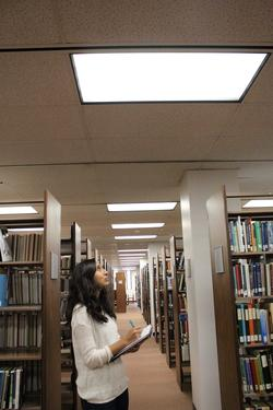 Lynae Salgado, student intern and manager for the Cal Poly Pomona team, takes notes during a lighting audit of the campus' main library