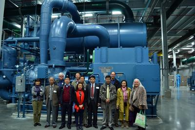The VCEP group standing in front of an 8,000 ton chiller in the Thermal Energy Corporation in Houston.