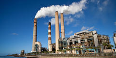 A power plant in operation emitting pollution.