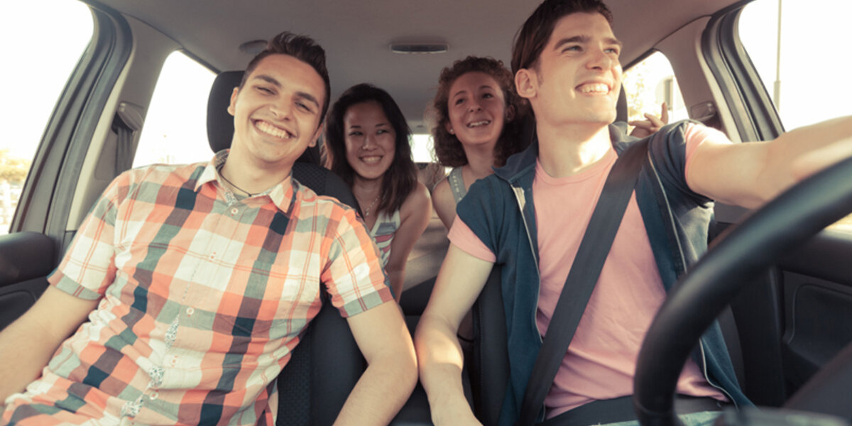 Four Friends Driving On a Summer Road Trip